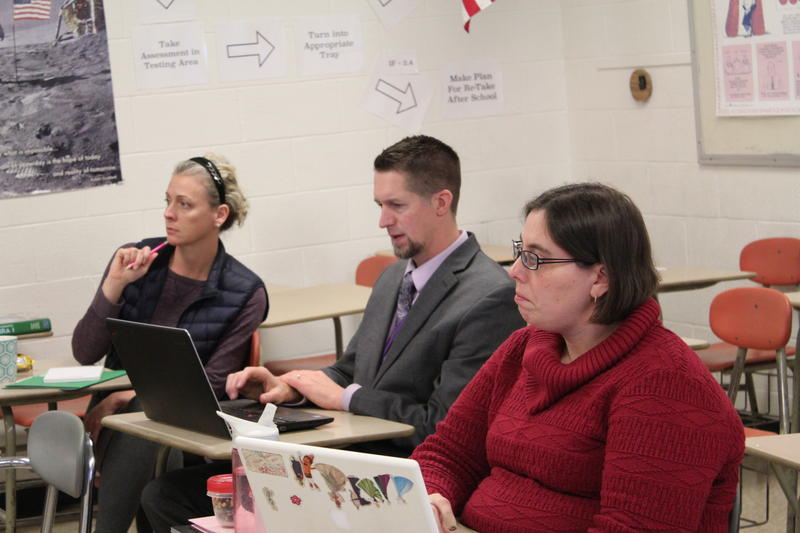 Bucksport High School Principal Bill Tracy (center) works with his staff on analyzing all of the school's 80 freshmen as part of the district's BARR program.