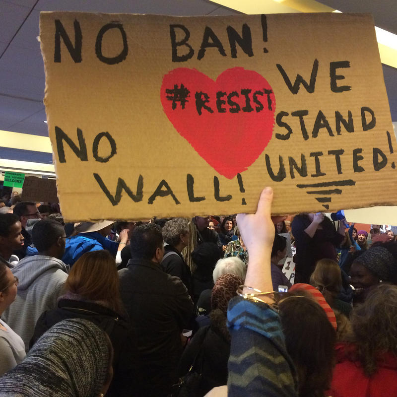 Hundreds of protesters pack the Portland International Jetport Sunday to protests President Trump's refugee ban.