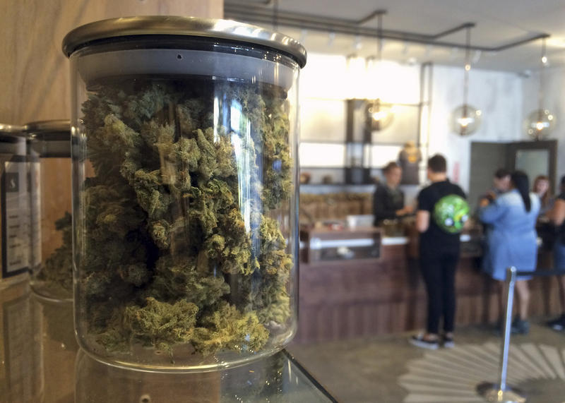 Customers buy products at a marijuana dispensary in San Francisco, CA.