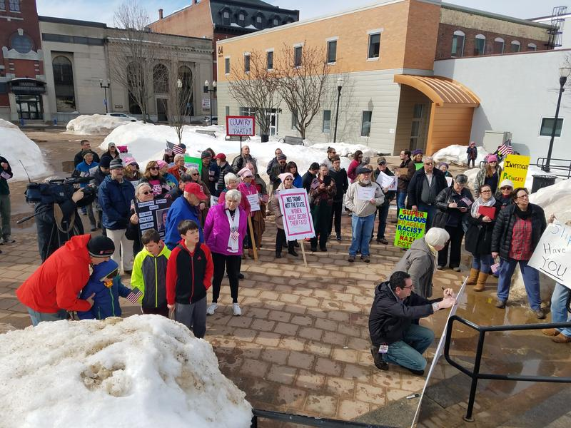 Protesters outside U.S. Sen. Susan Collins' Lewiston office on Wednesday.