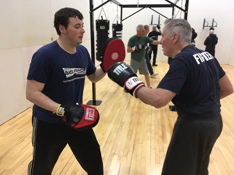 Ted Reese (right) with Rock Steady Boxing instructor Zach Hartman.