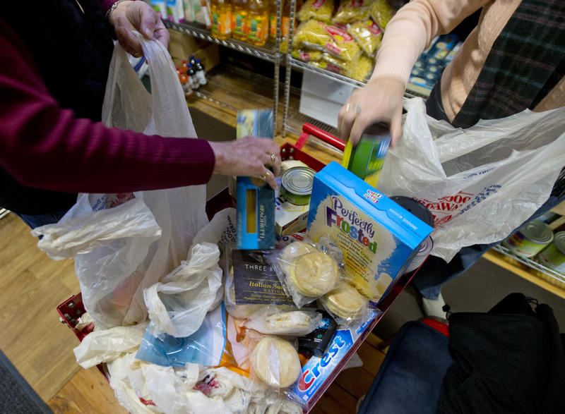 Volunteers fill bags with food for a customer at the Interfaith Food Pantry at Emmanuel Baptist Church in Feb. 2016, in Albany, New York