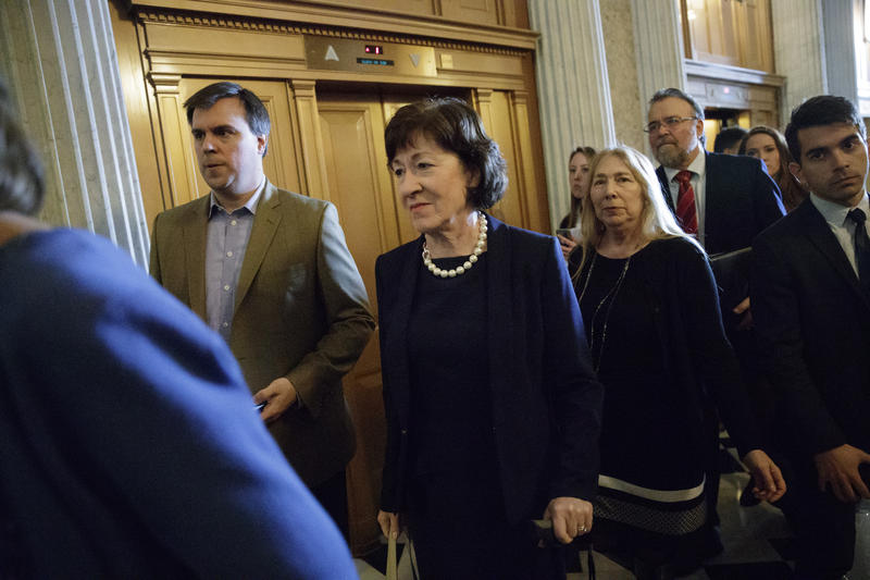 Sen. Susan Collins, R-Maine, center, who defected from the GOP majority, arrives at the Senate chamber on Capitol Hill in Washington Tuesday as the Senate voted for Education Secretary-designate Betsy DeVos.