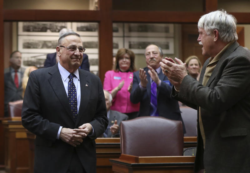 Gov. Paul LePage is applauded by legislators as he arrives to deliver the State of the State address, Tuesday, Feb. 7, 2017, at the State House in Augusta.