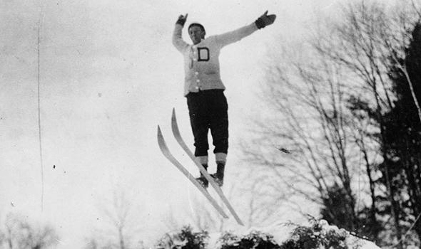 Fred Harris, Class of 1911, founder of the Dartmouth Outing Club, soars through the air following his jump at the first Winter Carnival, which took place in 1911.