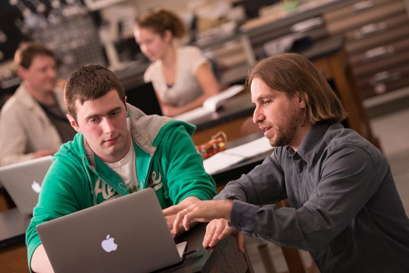 Professor Scott Dobrin works with a student in a biology class at the University of Maine at Presque Isle.