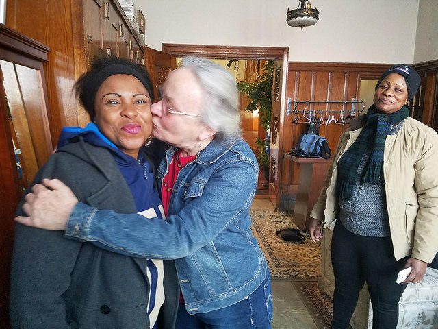 Cecile Thornton embraces Fatuma Lukusa at start of French Club. Lukusa is from the Democratic Republic of Congo.