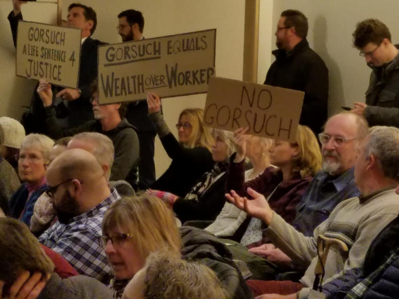 Supporters and opponents of President Trump's Supreme Court nominee Neil Gorsuch turn out at a listening session in Portland Sunday.