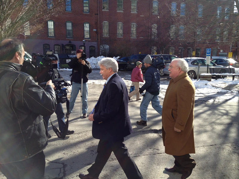 Attorney Dan Lilley walks behind his client Mark Strong as they leave court in 2013.