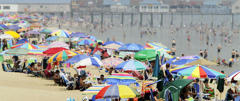 Beach enthusiasts crowd the shores of Old Orchard Beach on a hot summer day in July 2011.