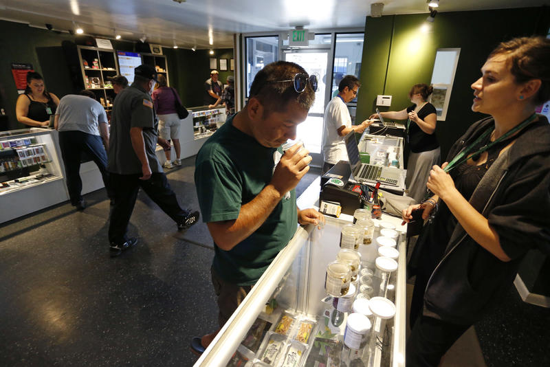 Customers shop for marijuana inside a recreational marijuana store, in Denver, Colo. in September of 2015.