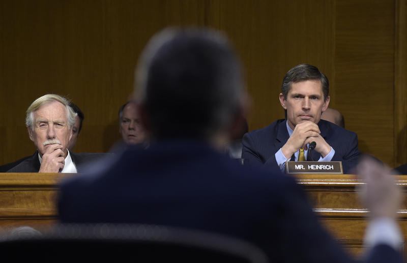 Sen. Angus King, I-Maine, left, and Sen. Martin Heinrich, D-N.M., right, listen as Clint Watts, center, a Senior Fellow at the Foreign Policy Research Institute Program on National Security, testifies before the Senate Intelligence Committee hearing.