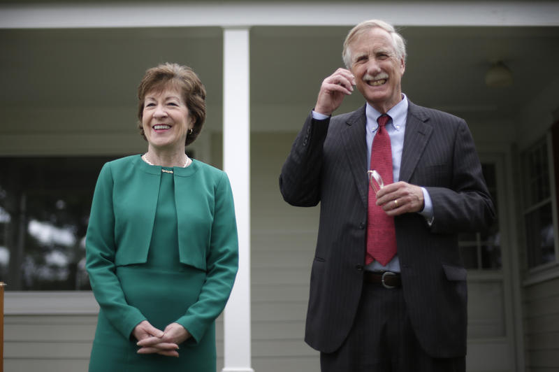 FILE - Republican Sen. Susan Collins and  independent Sen. Angus King speak to reporters after King announced his endorsement in her bid for a fourth term, Friday, May 16, 2014, at the Margaret Chase Smith Library in Skowhegan, Maine.