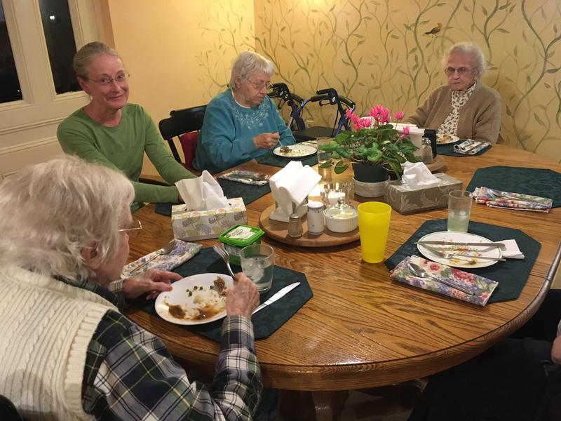 "Jill Wallace (second from left) runs a ""small, family-style assisted living"" in a 1800s-era house in Topsham."