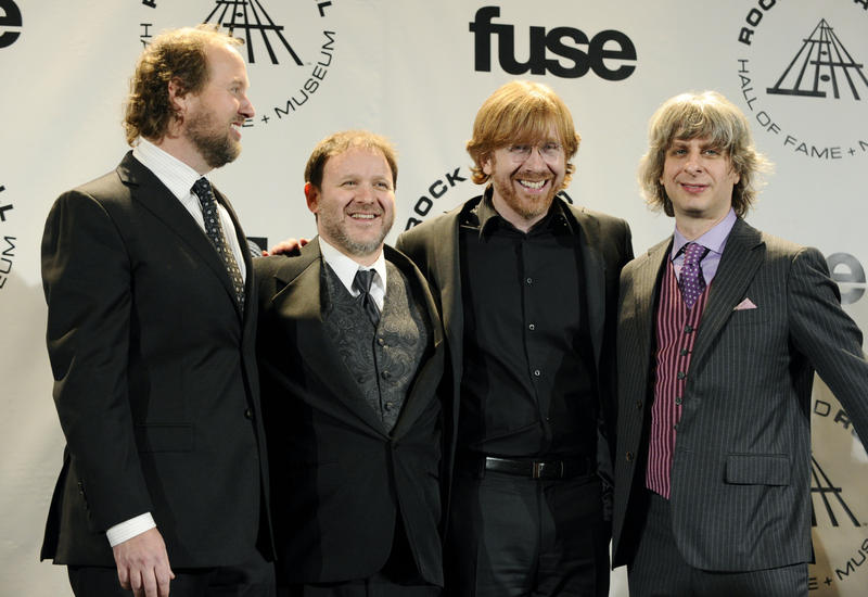 Jon Fishman (second from right) joins band members (left to right) Page McConnell, Trey Anastasio and Mike Gordon for photos after performing at the Rock and Roll Hall of Fame induction ceremony in New York in 2010.