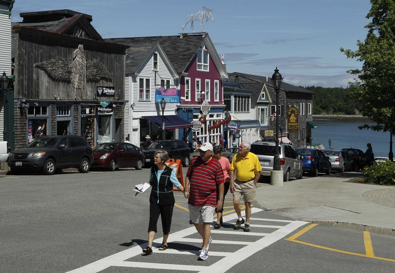 In this June 4, 2010 photo, tourists stroll through Bar Harbor, Maine, during a visit by the cruise ship Maasdam.
