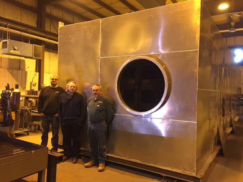 David Cook (from left), senior project manager at Fastco in Lincoln; Stephean Chute, managing director of Phyto-Charter Inc. and Allen Smith, president of Fastco with one of the two prototype Phyto-Charter Shipboard Heat Treating System units.