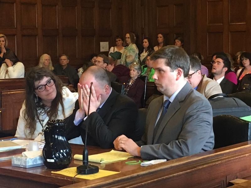 Anthony Sanborn Jr. holds his face in his hands in court Thursday, alongside attorneys Amy Fairfield (left) and Kevin Moynihan.