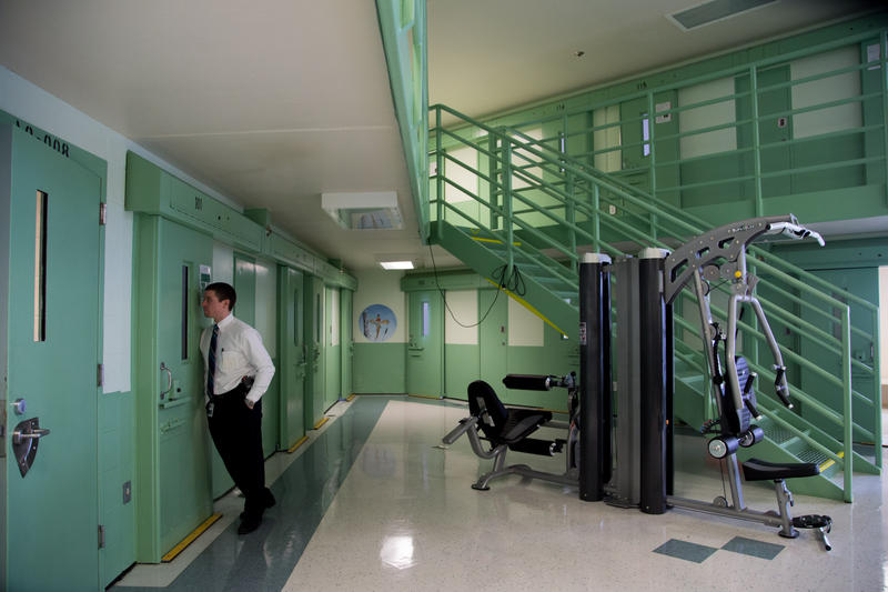 Associate Commissioner Dr. Ryan Thornell talks to an unidentified inmate in the Special Management Unit, where prisoners are held in solitary confinement for disciplinary reasons.