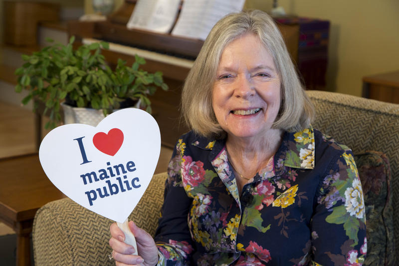 Maine Public member and Coastal Maine Botanical Gardens board member Marianne Reynolds proudly shows her support of Maine Public.
