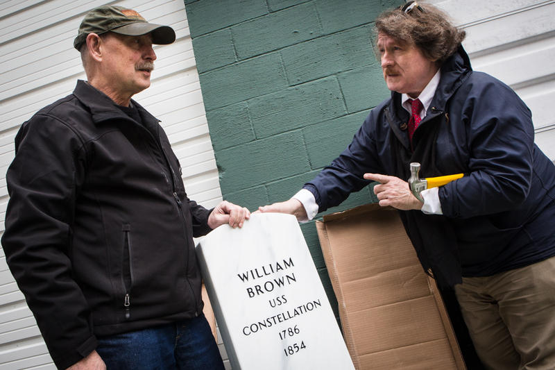 Larry Glatz (left) and Herb Adams with William Brown's gravestone after unwrapping it.