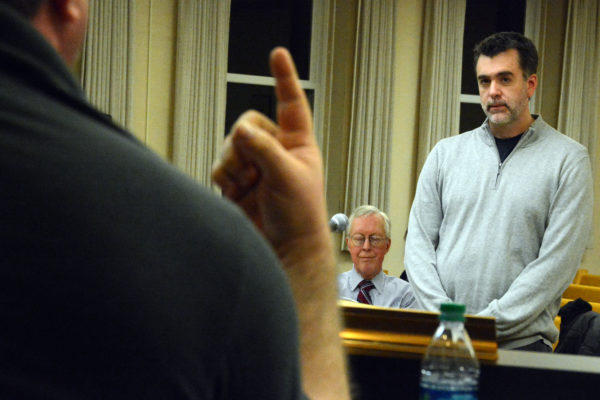 Our Katahdin President Sean DeWitt (right) listens as Millinocket Town Councilor Jesse Dumais makes a point during a council meeting in January in Millinocket.