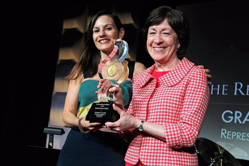 Senator Collins (right) received the GRAMMYs on the Hill Award from Maine resident, musician, and former American Idol judge, Kara DioGuardi