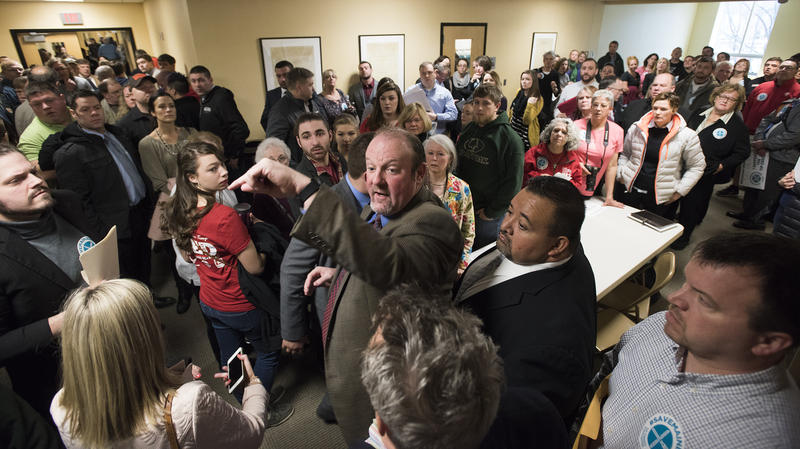 In the packed hallways of the Cross office building Cory King, executive director of the Southern Midcoast Maine Chamber, offers direction to people who wish to offer testimony either in favor of or opposed to the return of the tip credit.