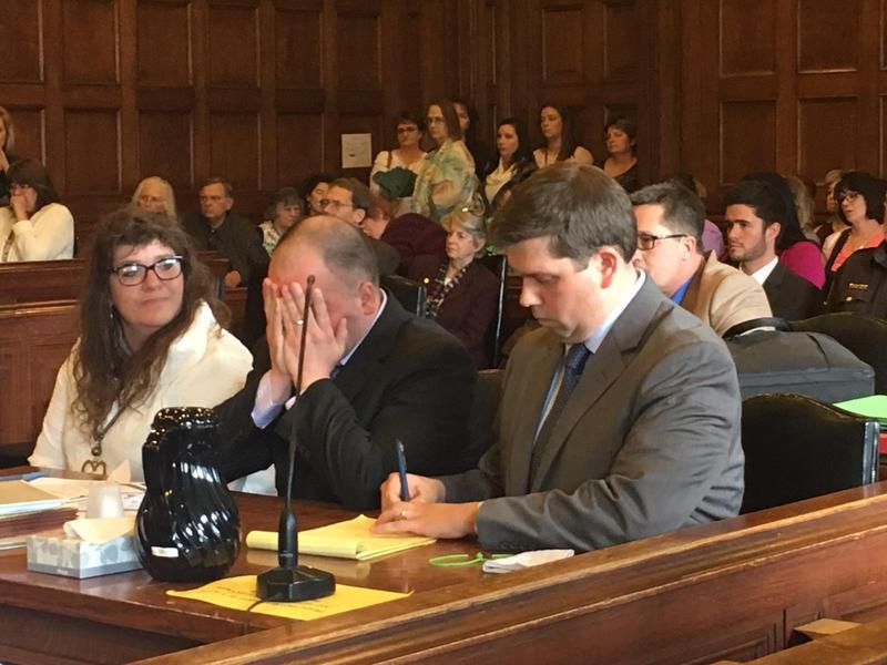 Anthony Sanborn Jr., center, breaks down in court last month.