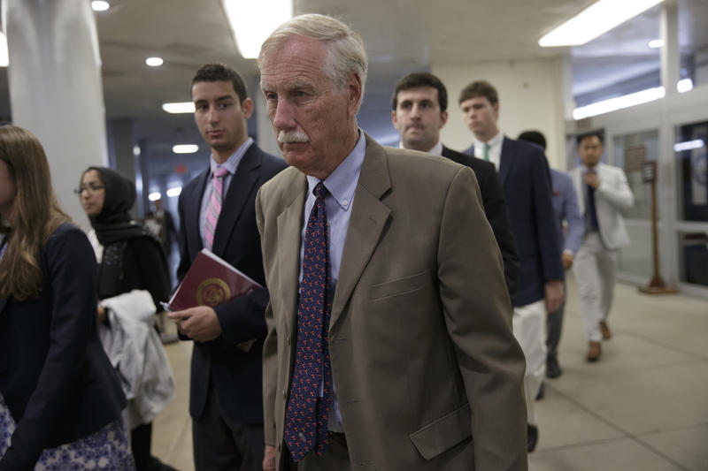 Sen. Angus King and other senators head to the Senate chamber on Capitol Hill in Washington on June 29, 2016 to vote as a rescue package for debt-stricken Puerto Rico.