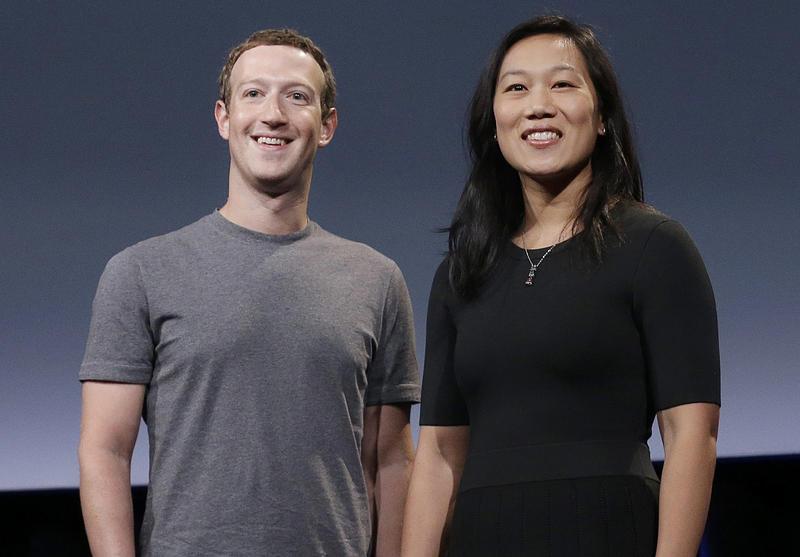 FILE: In this Tuesday, Sept. 20, 2016, photo, Facebook CEO Mark Zuckerberg and his wife, Priscilla Chan, smile as they prepare for a speech in San Francisco.