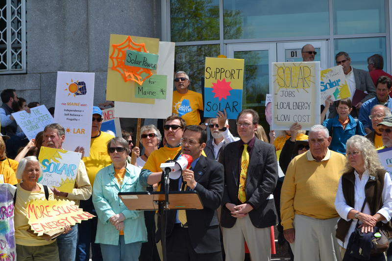 At the lectern, state Rep. Seth Berry addresses a rally in support of solar power in Augusta Thursday.