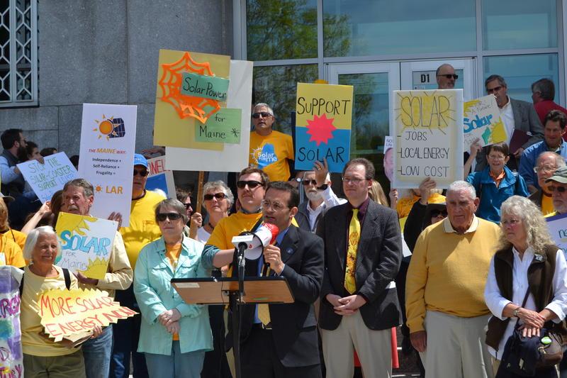 Rep. Seth Berry, D-Bowdoinham, sponsor of the solar bill, addresses ralliers Thursday in Augusta.