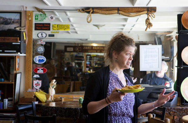 Rebekah Anderson, owner of the Lakeshore House, talks with a customer at her restaurant in Monson Thursday.
