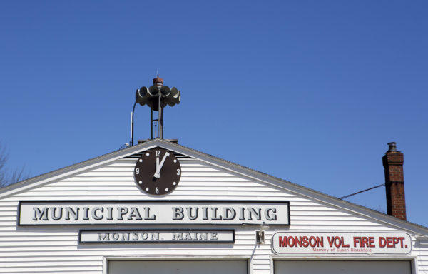 The Municipal building and volunteer fire department are seen in downtown Monson.