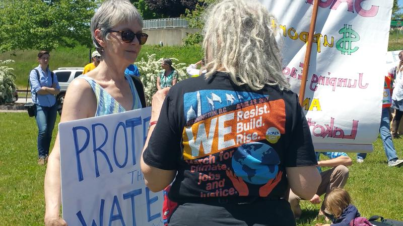 Lisa Savage, left, says she was born on the banks of the river, and believes in the Penobscots' cause to protect the waterway.