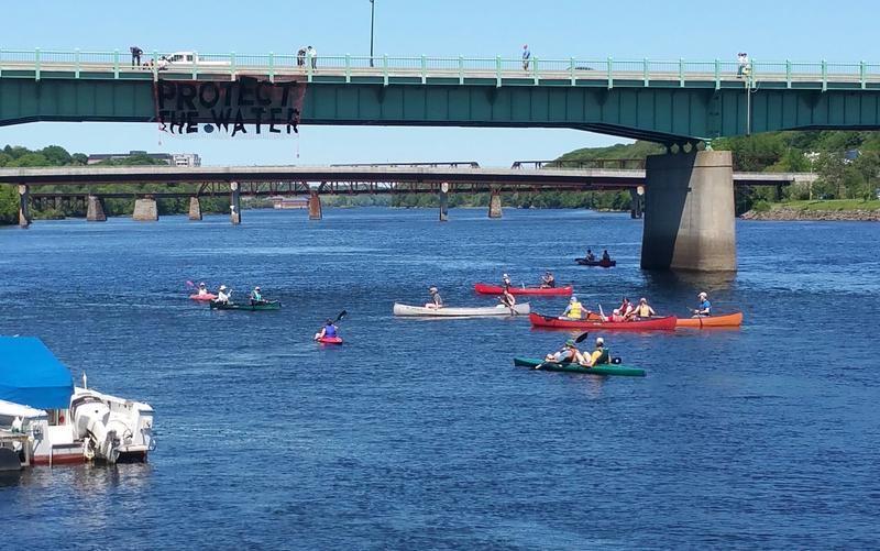 A flotilla paddled in support of the Penobscot River and water everywhere.