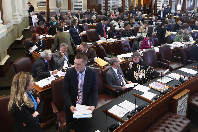 Lawmakers discuss business in the House Chamber as the Maine Legislature reconvenes Wednesday, Jan. 4, 2017, at the State House in Augusta, Maine.