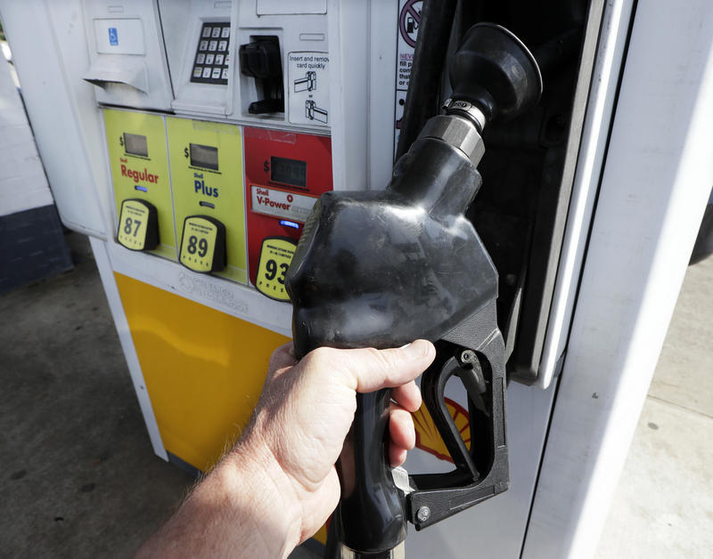 In this April 26, 2017, photo, gas is pumped at a filling station in Nashville, Tenn. By air or car, summer 2017 travel numbers are expected to rise over the previous year thanks to deals on airfares and stable gasoline prices.