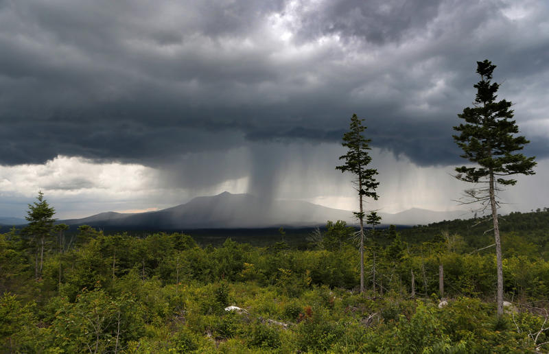 A rain storm passes over Mt. Katahdin in this August 2015 view from land that is now the Katahdin Woods and Waters National Monument in northern Maine.