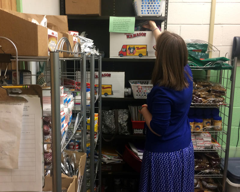 Rumford Elementary School teacher Sarah Lambert stocks her school's small food pantry. The school is one of many across Maine that has added new services beyond the classroom in recent years.