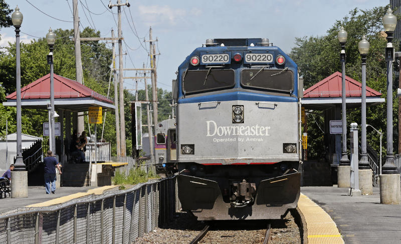 FILE - Amtrak's Downeaster train, headed for Portland, Maine from Boston, pulls out of the station in Haverhill, Mass., Tuesday, July 10, 2012.