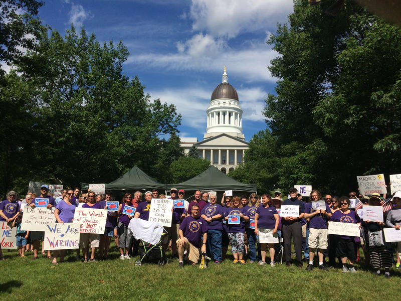 Maine's government shutdown entered its third day on Monday, July 3, 2017, as union members hold a rally across from the Maine State House in Augusta, Maine.