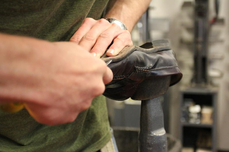 Ryan Trundy, 19-year-old apprentice at Yankee Cobbler in Bangor, works on a shoe.