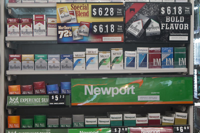 Packs of cigarettes are offered for sale at a convenience store in Helena, Mont., on Thursday, May 18, 2017.