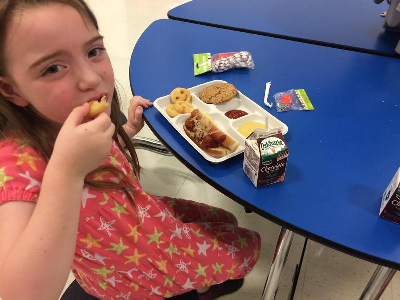 A student eats lunch at the summer meal site at SeDoMoCha Middle School in Dover-Foxcroft.