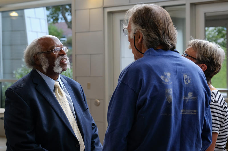 Veteran Carl Toney (Left) talks with attendees before the event.