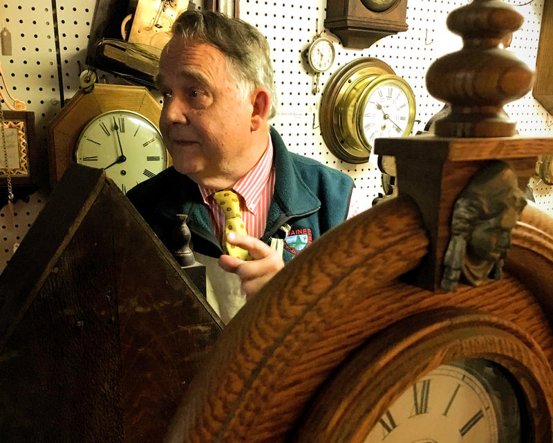 Almost every inch of Alexander Phillips' shop is occupied by clocks awaiting repair.