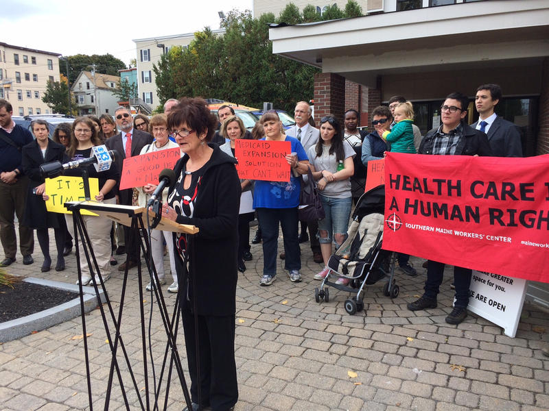 Kathleen Phelps, who needs insurance, speaks in favor of expanding Medicaid at a news conference in Portland Oct. 13, 2016.