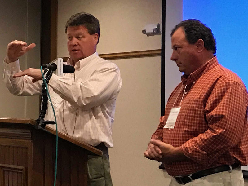 Fiberight LLC CEO Craig Stuart-Paul, left, gestures during a meeting of the Maine Resource Recovery Association in Brewer Monday as Greg Lounder, executive director of the Municipal Review Committee looks on.